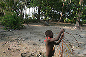 "A child plays in the ""garden"", an area formerly used for growing crops, but now destroyed by salt sea water waves, Puil Island, Carteret Atoll, Papua New Guinea, on Sunday, Dec. 10, 2006."