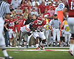 Ole Miss linebacker Allen Walker (9) forces a fumble by Arkansas running back Ronnie Wingo Jr. (20) at Reynolds Razorback Stadium in Fayetteville, Ark. on Saturday, October 23, 2010.