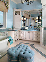 The master bath has lots of storage. Custom cabinetry with beach glass tile lavatory back splash.