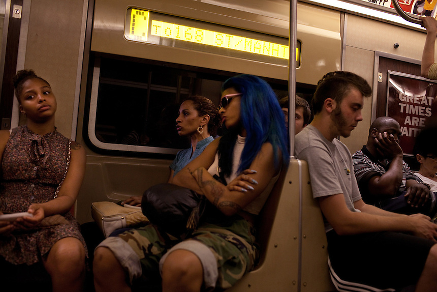 Commuters ride the A Train through Manhattan near the 14th Street subway stop in Chelsea, New York on June 24, 2012.