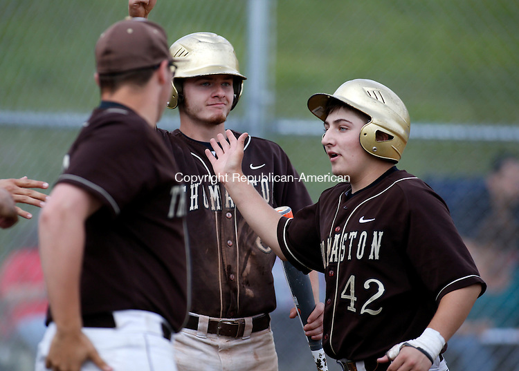 Thomaston, CT- 04 June 2015-060415CM03-  Thomaston's Jake Torrence (42) is congratulated by teammates Rich Revere, left, and Matt Tehan (8) after scoring a run against Sacred Heart on Thursday.  Thomaston would go onto win, 7-1.    Christopher Massa Republican-American