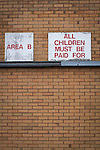 """Motherwell 3 Dundee 1, 12/12/2015. Fir Park, Scottish Premiership. A sign reading """"All children must be paid for"""" on the wall of a stand at Fir Park, home to Motherwell Football Club, before they played Dundee in a Scottish Premiership fixture. Formed in 1886, the  home side has played at Fir Park since 1895. Motherwell won the match by three goals to one, watched by a crowd of 3512 spectators. Photo by Colin McPherson."""