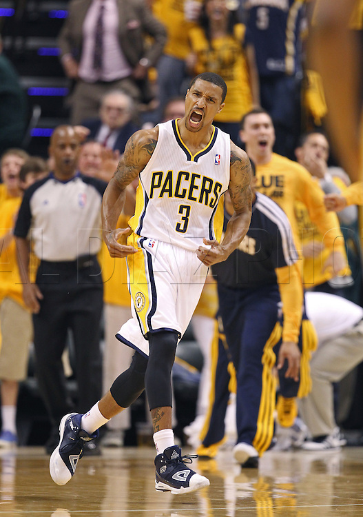 George Hill celebrates in the first quarter of Game 4 of the NBA Eastern Conference Finals at Bankers Life Fieldhouse in Indianapolis on Tuesday, May 28, 2013.