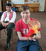 """Holding the """"Olympic Torch"""" and talking about the different sports, Movement & Music, Learning Support group with their carers,  Adult Learning Centre, Guildford, Surrey."""