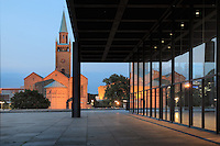 The Neue Nationalgalerie or New National Gallery at night, a modern art museum at the Kulturforum in West Berlin, Germany. The building and its sculpture gardens were designed by Ludwig Mies van der Rohe, 1886-1969, and opened in 1968. In the background is the St Matthaus-Kirche. Picture by Manuel Cohen