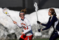 Amanda Spinnenweber (23) of Maryland looks for space around Megan Spagnola of Richmond at the practice turf field in College Park, Maryland.  Maryland defeated Richmond, 17-7.