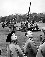 Anti-aircraft guns in Hyde Park go into action as &quot;enemy bombers&quot; make a daylight raid on London, during giant air defense exercises in which over 20,000 men and 1,300 RAF planes are taking part.  August 1939.  New York Times Paris Bureau Collection.  (USIA)<br /> Exact Date Shot Unknown<br /> NARA FILE #:  306-NT-901-73<br /> WAR &amp; CONFLICT BOOK #:  1001