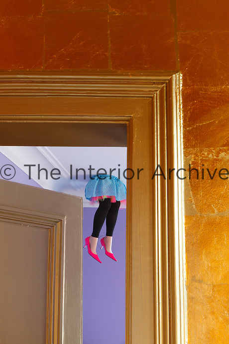 The rooms are full of quirky touches such as these mannequin legs appearing to fall through the ceiling of the dining room
