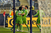Alvaro Fernandez (15) of the Seattle Sounders FC celebrates scoring with teammates in the 90th minute. The Philadelphia Union and the Seattle Sounders FC played to a 1-1 tie during a Major League Soccer (MLS) match at PPL Park in Chester, PA, on April 16, 2011.