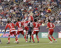New England Revolution midfielder Pat Phelan (28) and FC Dallas midfielder/forward Brek Shea(20) compete for a header from a corner kick.  The New England Revolution drew FC Dallas 1-1, at Gillette Stadium on May 1, 2010