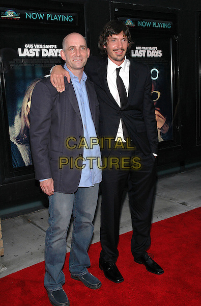 """DANY WOLF & LUKAS HAAS.The premiere of the new film, """"Last Days"""", at The Sunshine Theater in Manhattan, New York, New York..July 19th, 2005.Photo Credit: Patti Ouderkirk/AdMedia.full length Danny arm over shoulder jeans denim black suit.www.capitalpictures.com.sales@capitalpictures.com.© Capital Pictures."""