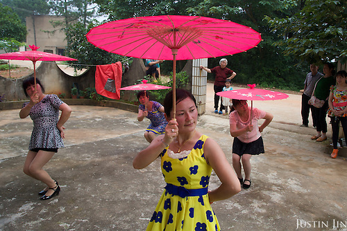 Women dance in southwestern China in a rural area that is soon to be urbanised.<br /> <br /> China is pushing ahead with a dramatic, history-making plan to move 100 million rural residents into towns and cities over the next six years.<br /> <br /> Moving farmers to urban areas is touted as a way of changing China&rsquo;s economic structure, with growth based on domestic demand for products instead of exporting them.