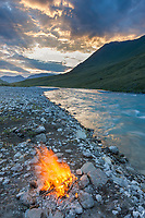 Campfire at sunset along the Marsh Fork of the Canning river, Brooks range mountains, Arctic National Wildlife Refuge, arctic, Alaska.