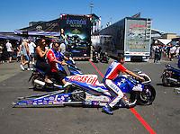 Jul. 26, 2014; Sonoma, CA, USA; Crew members push NHRA pro stock motorcycle rider Hector Arana Jr through the pits during qualifying for the Sonoma Nationals at Sonoma Raceway. Mandatory Credit: Mark J. Rebilas-