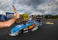 Sep 18, 2016; Concord, NC, USA; NHRA funny car driver John Force pulls off the track after winning the Carolina Nationals at zMax Dragway. Mandatory Credit: Mark J. Rebilas-USA TODAY Sports