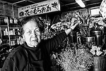 "Atsuko Muraoka, 85, shows off some of her goods at her flower shop in Yubari City, on the northernmost island of Hokkaido in Japan. ""Not long ago, many people came to study ikebana, the ancient art of flower arranging,"" says Muraoka. ""Now there's nobody left to study it. Our cultural heritage is going the same way as the city -- bankrupt.""  ."