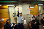 Tokyo, 1st of March 2010 - Tuna at Tsukiji wholesale fish market, biggest fish market in the world. 5:35 a.m, auction for the frozen tunas. More than 160t of frozen tunas are sold every day at Tsukiji fish market.
