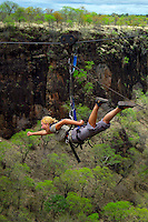 LIVINGSTONE, VICTORIA FALLS, ZAMBIA, DECEMBER 2004. De Flying Fox in superman style. Victoria falls on the border between Zambia and Zimbabwe is the outdoor adventure capital of Africa. Photo by Frits Meyst/Adventure4ever.com