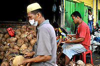 Workers process coconuts, one of the main export commodities from this region. The 1999-2002 religious war between Maluku's Christian and Muslim populations, mainly centred on Ambon Island, led to over 5000 deaths and to around 500,000 people become displaced. Destroyed homes and offices, churches and mosques are slowly being either torn-down or renovated.  Urban centres, such as Ambon City, continue to be split along largely sectarian lines, and tensions are never far below the surface. Riots between Christian and Muslim youths erupted in September 2011 and, most recently, June 2012, though luckily simmered down just as quickly, partly due to community leaders learning how to defuse tensions from the earlier, more devastating, conflagration. /Felix Features