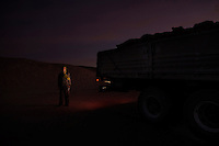 Bud Buda Cheikh, 41. Oxfam temporary worker. Pictured during food distribution in Smara refugee camp, Algeria: 'I was born in Mijek in 1968. We lived in a peaceful way. When it rained we were in the desert with the camels, when it was dry we lived in Dakhla. All I remember of Dakhla now is the sea and eating fish.' ..