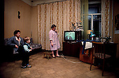 Moscow, Russia<br /> Soviet Union<br /> December 15, 1991<br /> <br /> A family at home in central Moscow eating dinner.<br /> <br /> In December 1991, food shortages in central Russia had prompted food rationing in the Moscow area for the first time since World War II. Amid steady collapse, Soviet President Gorbachev and his government continued to oppose rapid market reforms like Yavlinsky's &quot;500 Days&quot; program. To break Gorbachev's opposition, Yeltsin decided to disband the USSR in accordance with the Treaty of the Union of 1922 and thereby remove Gorbachev and the Soviet government from power. The step was also enthusiastically supported by the governments of Ukraine and Belarus, which were parties of the Treaty of 1922 along with Russia.<br /> <br /> On December 21, 1991, representatives of all member republics except Georgia signed the Alma-Ata Protocol, in which they confirmed the dissolution of the Union. That same day, all former-Soviet republics agreed to join the CIS, with the exception of the three Baltic States....