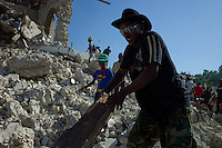 Leogane, Haiti, Jan 22, 2010.A crowd of approximately 2000 gathers for a food distribution next to the destroyed town church; a platoon of UN soldiers from Canada and Sri Lanka can't contain the pressure for very long, so the distribution has to come to a rapid end..