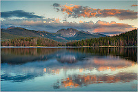 On a calm evening near Winter Park, Colorado, this quiet lake is found in the Arapaho National Forest area. This Colorado image features Meadow Creek with Mount Neva in the background on a summer sunset.