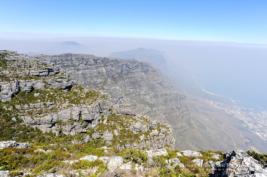 Table Mountain is a flat mesa  overlooking the city of Cape Town in South Africa.