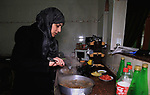 Aisha al-Baroud, 44, a Palestinian woman with breast cancer cooks at her house in the northern Gaza stirp on Feb. 13, 2017. al-Baroud with breast cancer for more three years makes artificial breasts for mastectomy survivors for free, and she dosen't completed her treatment in Israeli hospitals because Israeli rejection. according health information center, breast cancer comes first By 17.8% of total cancer cases in Gaza strip. Photo by Khaled Abu Alouf