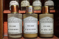Glass jars in the pharmacy in Les Hospices de Beaune, or Hotel-Dieu de Beaune, a charitable almshouse and hospital for the poor, built 1443-57 by Flemish architect Jacques Wiscrer, and founded by Nicolas Rolin, chancellor of Burgundy, and his wife Guigone de Salins, in Beaune, Cote d'Or, Burgundy, France. The jars contain medicinal ingredients such as ground woodlice, ground augusture root and ground yellow sea urchin. The hospital was run by the nuns of the order of Les Soeurs Hospitalieres de Beaune, and remained a hospital until the 1970s. The building now houses the Musee de l'Histoire de la Medecine, or Museum of the History of Medicine, and is listed as a historic monument. Picture by Manuel Cohen