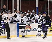 The Falcons celebrate Gensler's goal. - The Bentley University Falcons defeated the College of the Holy Cross Crusaders 3-2 on Saturday, December 28, 2013, at Fenway Park in Boston, Massachusetts.