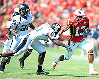 WR Kerry Boykins of the Terrapins stiff arms Ashlyn Parker of the Panthers. Maryland defeated FIU 42-28 during a game at Capital One Field at Byrd Stadium in College Park, MD on Saturday, September 25, 2010. Alan P. Santos/DC Sports Box