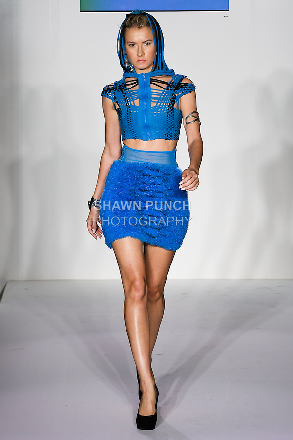 Model walks runway in an outfit by Zula Khramov and Maleku jewerly by Ileana Maria Rojas-Bennett, for the Zula Studio fashion show, at Nolcha Fashion Week Spring 2012.