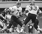 Joe Theismann Toronto Argonauts Quarterback hands the ball off to Bill Symons fullback 1971. Copyright photograph Scott Grant/