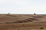 An oil well dots the sparse landscape of western Nebraska.