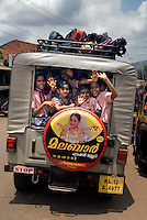 Wayanad, Kerala, India, April 2008. school children are crammed into the back of a jeep. The Wayanad district of Kerala offers wildlife viewing opportunities, an insight into tribal culture evocative of earlier centuries, trekking and other adventure activities. Photo by Frits Meyst/Adventure4ever.com