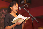 """Adrianna Mauzy reads a poem at """"Creative Arts as Activism – Social Justice-Themed Open Mic Night,"""" at Casa Nueva Restaurant and Cantina on January 20, 2016. The open mic night was one of many MLK Jr. Celebration events. ©Ohio University/Photo by Kaitlin Owens"""
