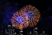 Fireworks are seen while The Empire State Building is lit in red and gold in honor to the Chinese New Year in New York, 02/06/2016. Photo by VIEWpress
