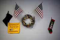 Christmas decorations and American flags hang on a wall in the Newt Gingrich New Hampshire campaign headquarters in Manchester, New Hampshire, on Jan. 7, 2012. Gingrich is seeking the 2012 Republican presidential nomination.