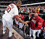 30 September 2009: Washington Nationals' outfielder Justin Maxwell (30) gets congratulated by teammates after a game against the New York Mets at Nationals Park in Washington, DC. The Nationals rallied in the bottom of the 9th inning on Maxwell's walk-off Grand Slam to win 7-4 and sweep the Mets 3-game series capping the Nationals' 2009 home season. Mandatory Credit: Ed Wolfstein Photo
