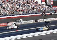 Nov 13, 2016; Pomona, CA, USA; NHRA top fuel driver Antron Brown (left) alongside Morgan Lucas during the Auto Club Finals at Auto Club Raceway at Pomona. Mandatory Credit: Mark J. Rebilas-USA TODAY Sports