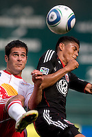 Andy Najar (14) of D.C. United has the ball cleared away from him by Mike Petke (12) of the New York Red Bulls at RFK Stadium in Washington, DC.  The New York Red Bulls defeated D.CC United, 2-0.