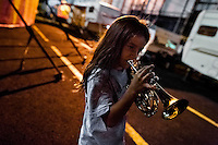 A young boy, a member of the old circus family Fuentes Gasca from Mexico, plays trumpet in the backstage of Circus Renato, in San Salvador, El Salvador, 7 May 2011.