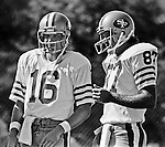 San Francisco 49ers training camp August 3, 1982 at Sierra College, Rocklin, California.  San Francisco 49ers quarterback Joe Montana 16) and wide receiver Dwight Clark (87).