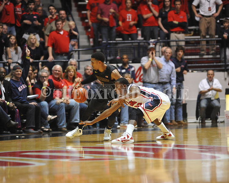 Missouri's Phil Pressey (1) vs. Ole Miss' Jarvis Summers (32) at the C.M. &quot;Tad&quot; Smith Coliseum on Saturday, January 12, 2013. Ole Miss defeated #10 ranked Missouri 64-49.