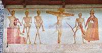Crucifiction fresco on the Church of San Vigilio in Pinzolo, part of its mural painting &ldquo;the Dance of Death&rdquo; painted by Simone Baschenis of Averaria in1539, Pinzolo, Trentino, Italy.<br /> <br /> The mural continues for another 21 meters with a long procession with 40 figures.<br /> <br /> The Mural opens on its left with a skeleton on the throne, bearing a sceptre and the crown and playing a bagpipe. These skeletons are playing the music which is the backdrop to &ldquo;Dance of Death&rdquo; ( Danza macabra ) and suggests that they are playing with our fate on earth.<br /> <br />  To the right of the skeletons playing music is a depiction of the crucification. Christ is depicted on the cross with an arrow in him that has been fired by a skeleton with a bow. This suggests that because Christ was a man he suffered the fate of death as we all will.<br /> After Christ is a Pope also pierced by a spear, as are all the human figures in the mural.