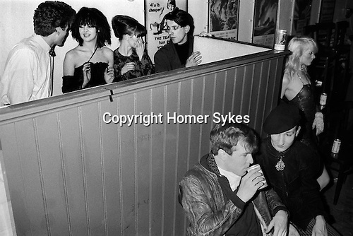 Blitz Club Covent Garden London 1980.<br /> <br /> Top row: Girl with black Bob hairstyle is Wendy May who was Billy Idol's girlfriend in the band Chelsea. Girl on right is Lorraine from the dance troupe Spoonoch. <br /> <br /> Man sipping can of beer is ?? talking to Stephen Jones in beret.  Wendy TigerPearson (Wendy Tiger Pearson)<br /> <br /> My ref 17a/4006/1980
