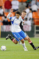 Montreal Impact forward Bernardo Corradi (23) goes against D.C. United midfielder Perry Kitchen (23) D.C. United tied The Montreal Impact 1-1, at RFK Stadium, Wednesday April 18 , 2012.