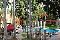 Guests using the swimming pool at the Hotel Hacienda Uxmal near the Mayan ruins of Uxmal, Yucatan, Mexico..