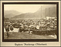 BNPS.co.uk (01202 558833)<br /> Pic: Tooveys/BNPS<br /> <br /> The Typhoon shelter at Aberdeen on the south of Hong Kong island had became floating city of Chinese junks.<br /> <br /> A fascinating set of early images of Hong Kong long before it became the metropolis it is today have surfaced. <br /> <br /> The black and white photographs dating to the early 20th century depict a region unrecognisable to what stands today. <br /> <br /> There are several shots of natives walking down packed low-rise streets while a number of others picture primitive sailing boats. <br /> <br /> The collection was compiled by adventurous British photographer Denis H. Hazell, who took each of the 26 postcard-like photos.